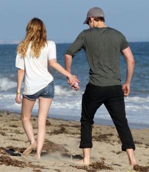 Emma Roberts And Chord Overstreet Walking On The Beach In Malibu
