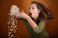 woman spilling beans