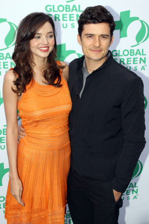Orlando Bloom and Miranda Kerr looking loved up on the red carpet for the 'Global Green USA' awards in Santa Monica