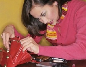 woman looking through purse