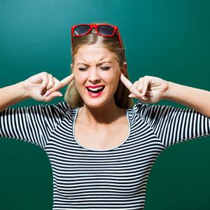 woman plugging ears 4