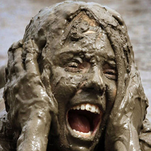 woman covered in mud