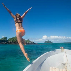 woman jumping off boat