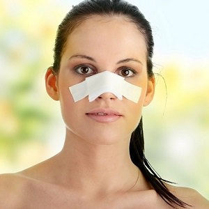 woman nose bandage