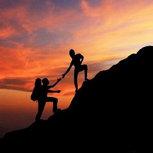 man woman mountain climbing