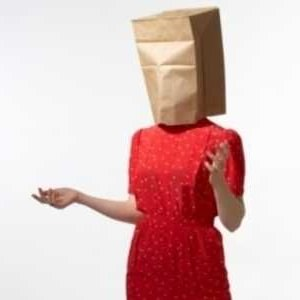 woman wearing paper bag