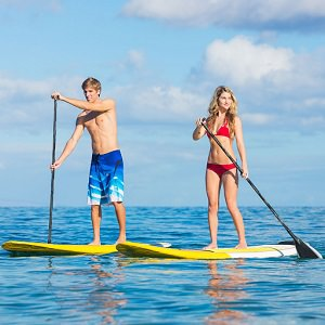 couple paddle board