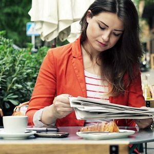 woman-coffee-newspaper